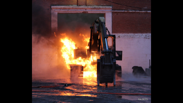 Oswego firefighters battle excavator fire at Port City Logistics