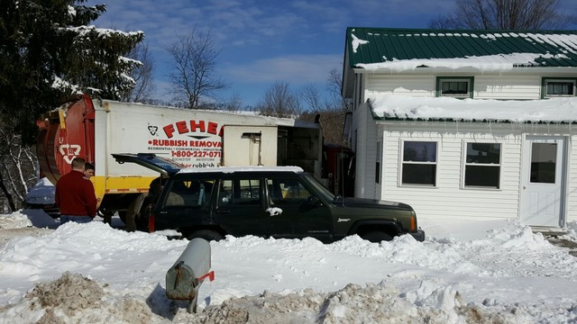 Garbage truck driver says faulty brakes caused him to crash into Tully home