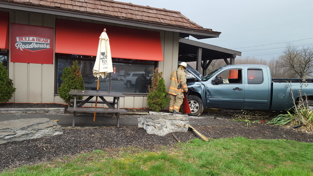 1 seriously injured after truck crashes in to East Syracuse bar