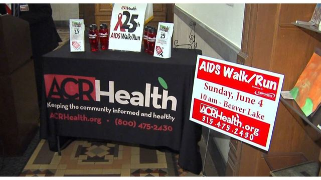 ACR kicks off AIDS Awareness Week with painting of red stripe Downtown