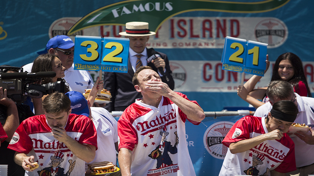 Nathan's hot dog 10X champ Chestnut wins again, sets new record