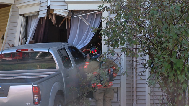Pickup truck crashes into house in Syracuse's South Side